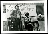 Canadian Farmworkers Union Founding Convention April 6, 1980. CFU President Raj Chouhan addresses the crowd after his election. CFU Secretary Treasurer Charan Gill claps.