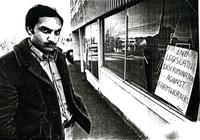 Farm Workers Organizing Committee President Raj Chouhan stands in front of vandalized FWOC store front office window.