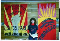 Canadian Farmworkers Union Fourth National Convention. CFU staff rep Judy Cavanagh. ESL Crusade banners by David Jackson.